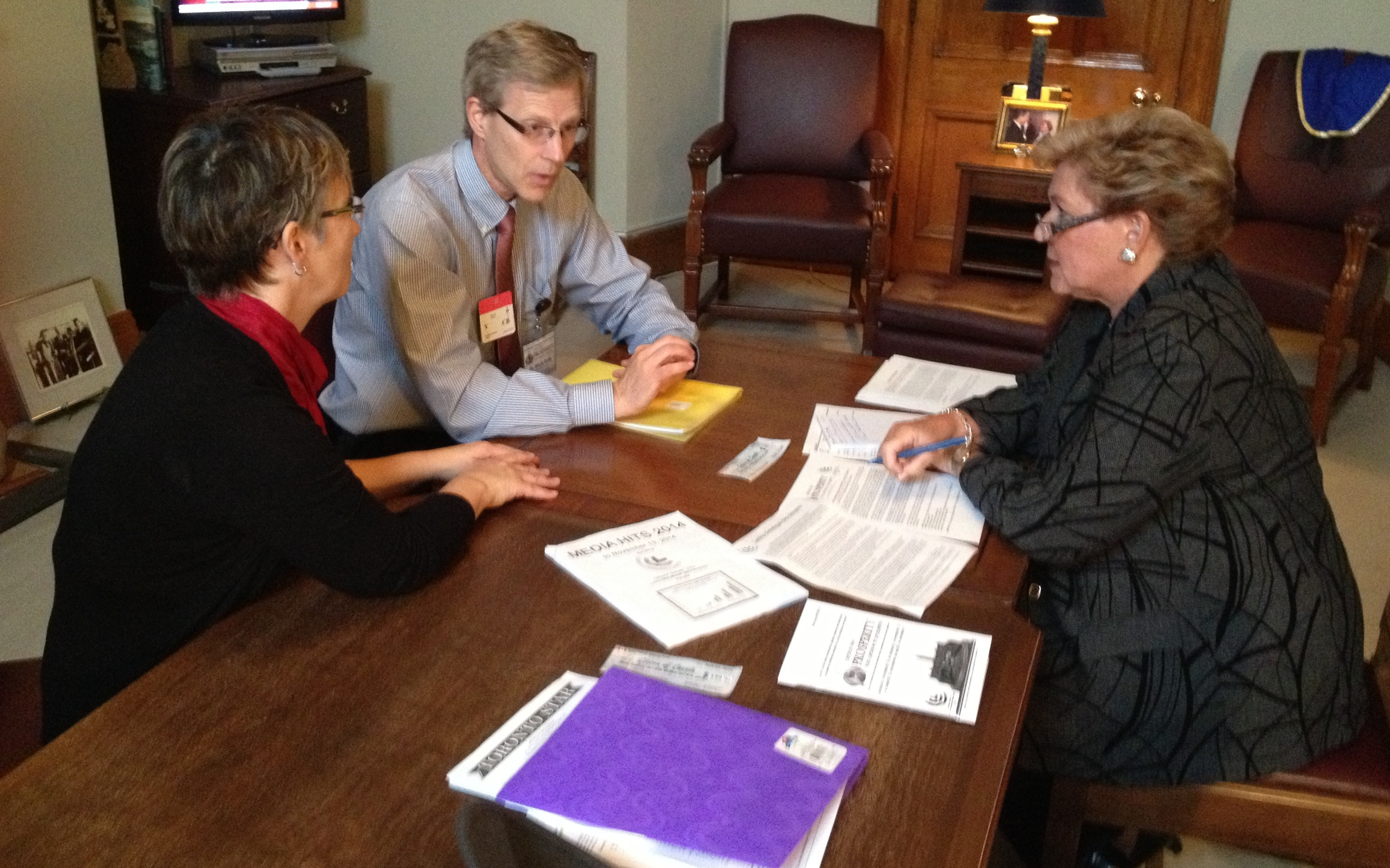 Author and her husband, Dr Mark Polle, meet with Senator Marie-P Charette-Poulin of northern Ontario (on right)